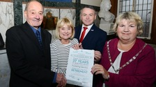 pic of foster carers receiving award
