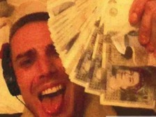 Drug dealer Jason Smith showing off money from his crimes