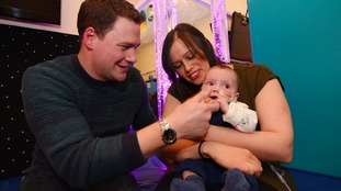 Parents desperate to hear their 'happy little baby' make a sound