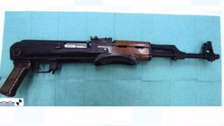 Terror suspect arrested after loaded AK-47 found in flat