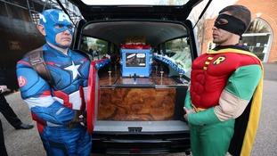 Arthur's coffin was decorated in superhero memorabilia