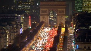 Rush hour in the French capital sees thousands of vehicles drive bumper to bumper past Champs Elysees Avenue.