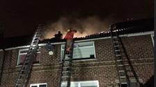 Fire crews tackling blaze in the roof in Swinton.