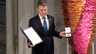 Santos with Nobel Peace Prize