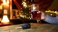 A pint next to a set of car keys.