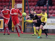 Portadown's Garry Breen and Cliftonville's Peter Burke in action.