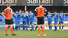 Alan Teggart of Dungannon celebrates after he scored a goal.