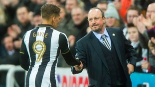 Newcastle United's manager Rafa Benetez congratulates hat-trick scorer Dwight Gayle after he is substituted.