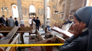 A nun stands at the scene inside Cairo's Coptic cathedral.