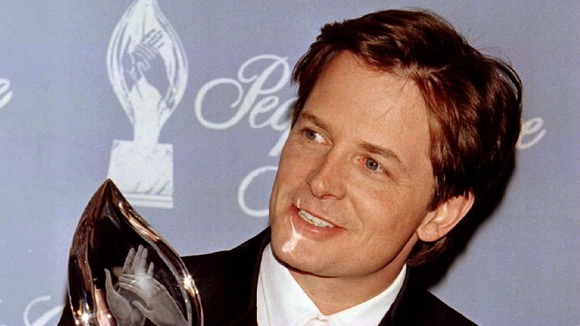 Michael J. Fox, who famously played Marty McFly in Back to the Future, pictured with an award in 1997.