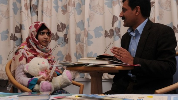 Ziauddin talks to his daughter at the hospital.