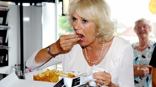 The Duchess of Cornwall tucking into fish and chips