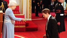 Actor Kenneth Branagh receives his knighthood from the Queen