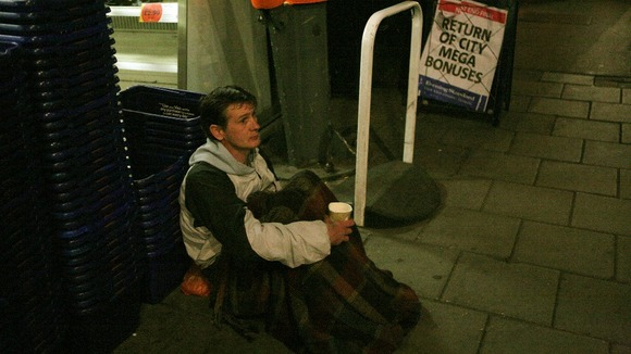 Homeless man outside Royal Festival Hall, South Bank Centre, London.