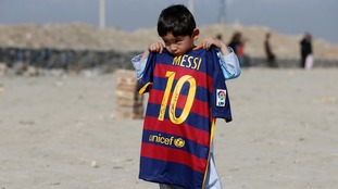 Murtaza with a signed Barcelona kit