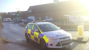 Two security guards were held at gunpoint at Asda in Witham, Essex