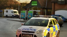 Police have sealed off the Asda supermarket in Witham after the security van robbery.