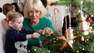 Sick children help Camilla decorate her Christmas tree at Clarence House