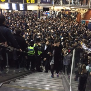 Commuters crammed into Liverpool Street station after the Central line was shut