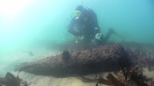Archaeologist David Gibbins with a gun revealed this year on the wreck of the  Schiedam