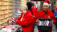 A busy day at the office for Royal Mail staff.