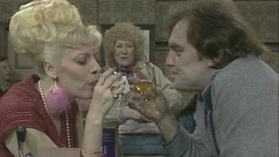 Jack Duckworth and Bet Lynch share a moment over drink watched by Vera Duckworth