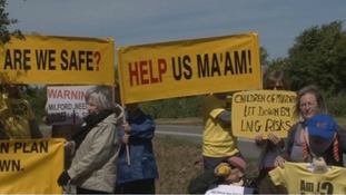 Protesters during royal opening of LNG terminal in 2009