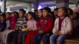 Mobile cinema takes the big screen to refugee families