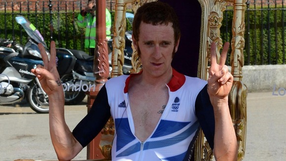 Bradley Wiggins apologised for his offending gesture yesterday and thanked the public for their support 