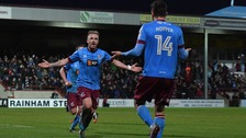 Paddy Madden scored twice in leaders Scunthorpe's home win over Millwall.
