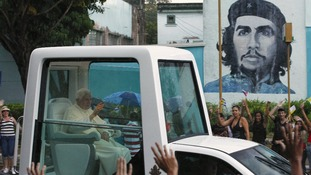 Pope Benedict XVI waves as he rides the popemobile on his way to the airport in Havana