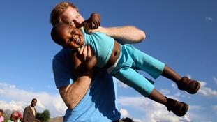 Prince Harry swinging three year old orphan Lerato