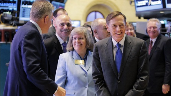 Former Central Intelligence Agency Director David Petraeus (right) pictured with his wife Holly at the New York Stock Exchange.