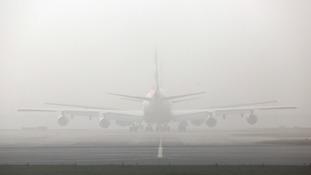 Plane in fog at Heathrow