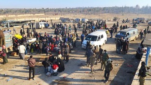 Evacuees from a rebel-held area of Aleppo arrive at insurgent-held al-Rashideen.