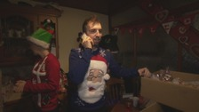 Cumbria's Santa, Richard Francis, prepares gifts for delivery
