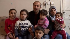 Abu Mohammed, his wife and their five children.