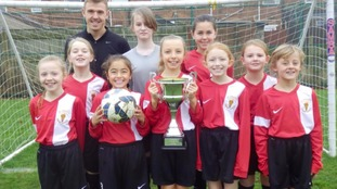 Johnathon Murray of St Aidan's Primary School is pictured with (left to right) Emilie Noble, Isabelle Smith, Olivia Skedd, Olivia Mowbray, Lexie Goldsmith, Tilly Burey, Isabelle Kay, Emily Henderson and Erin White