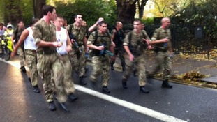 Royal Marines during their marathon speed-march in London today.