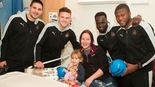 Ruby Louise Scott, three, with mum Claire, from Alnwick, with NUFCs Aleksandar Mitrovic, Freddie Woodman, Cheick Tiote and Chancel Mbemba