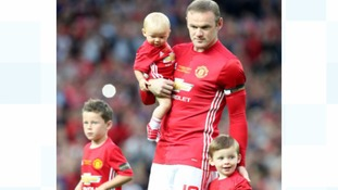 Wayne Rooney at his testimonial with his children