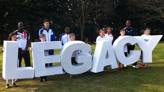Children and athletes spelling out the word &#x27;legacy&#x27;