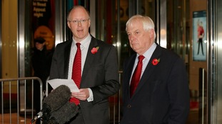 BBC director general George Entwistle (left) looks on as Chairman of the BBC Trust Lord Patten speaks to the media.