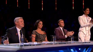 X Factor judges' applaud Jahmene Douglas's performance.