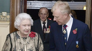 The Queen is greeted by the President of the Royal British Legion Vice-Admiral Peter Wilkinson.