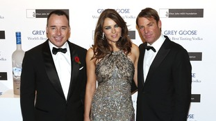 (From the left) David Furnish, Liz Hurley and Shane Warne arrive at the fundraiser.