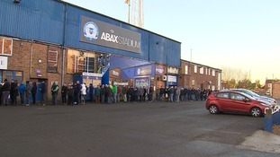 Peterborough United fans queueing outside the ABAX Stadium today.
