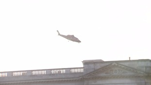 The helicopter carrying the Queen and Prince Philip takes off from Buckingham Palace.