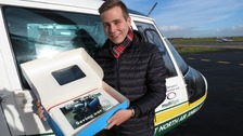 """James Kavanagh Dutschak with his """"thank you"""" cake for medics"""