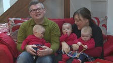 The triplets with mum Rachel and dad Steven
